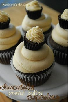 """Chocolate Peanut Butter Cupcakes are moist chocolate cupcakes topped with a luscious peanut butter frosting and adorned with a cute PB cup """"cupcake"""" topper! #peanutbutter #chocolate #cupcakes"""