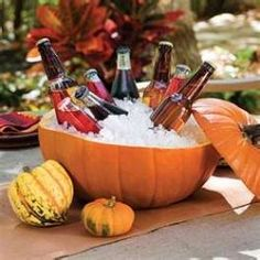 What a neat idea! Turn that oversized pumpkin into a festive cooler for beer or soda.