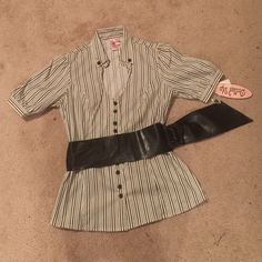 NWT shirt The shirt has a unique neckline and a wide belt with a loop. The belt can be removed. Included is an extra button. Tops Button Down Shirts