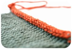 Beautiful I-cord binding gives a firm, no-curl edge.  Find it at http://tanglednews.wordpress.com/tutorials/i-cord-bind-off/