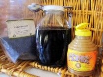 Every family should keep a jar of elderberry honey syrup in their refrigerator.  This simple, natural elixir is fabulous at preventing and treating illnesses and it couldn't be easier to make or more natural.    What's so great about elderberry syrup?    Elderberry syrup is one of the best things on the planet to fight illness.  It protects against multiple strains of flu and dramatically shortens flu durations for those who take it after they get sick, plus it increases the production of in...