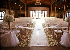 An indoor, rustic ceremony