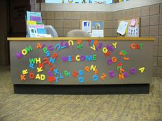 What a great use of space!  Could maybe do something similar with magnetic poetry. Menomonie Public Library's children's desk has an inviting new feature: a magnet board!