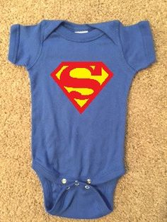 Superman Onesie - Boy Onesie - Childrens Clothing - Ruffles with Love - Baby Clothing - RWL Kids Blue onesie with yellow and red graphic! 100% combed ring-spun cotton 5 ounce ultra soft 1x1 baby rib k