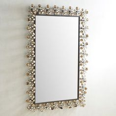 Designed to dazzle, our eye-catching tempered mirror is a brilliant statement piece. Surrounded by colorful, snowflake-like acrylic accents, it'll give your bedroom, hallway or living room an energy boost. And when you do a last-minute mirror check before work or a night out, you'll enjoy a confidence boost.
