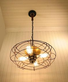 Reduce, reuse, and upcycle! An old fan can be repurposed as a quirky room light.  Photo:  Etsy