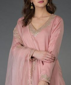 From our Indian Spring Collection, this Pearl Pink kurta and farshi palazzo suit is adorned with beautiful rose gold gota patti hand embroidery. The kurta and farshi ( wide leg palazzo pants) are crafted in fine bemberg modal and the dupatta is c Neck Designs For Suits, Dress Neck Designs, Blouse Designs, Embroidery Suits Punjabi, Embroidery Suits Design, Kurti Embroidery, Pakistani Dresses Casual, Pakistani Dress Design, Shadi Dresses