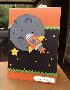 Case of card from here but using punches to make the spaceship.  http://www.pinterest.com/pin/492510909221484503/  l