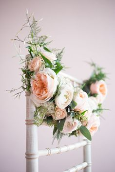 romantic wedding chair decoration with floral garland