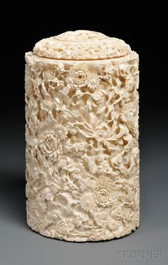 Ivory Container with Cover, China, 19th century, cylindrical, carved in high relief with flowers, dia. 5, ht. 9 1/2 in.