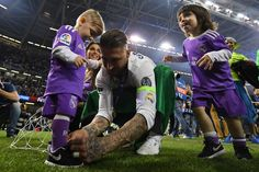 Sergio Ramos of Real Madrid ties his childs shoelace after the UEFA Champions League Final between Juventus and Real Madrid at National Stadium of Wales on June 3, 2017 in Cardiff, Wales.