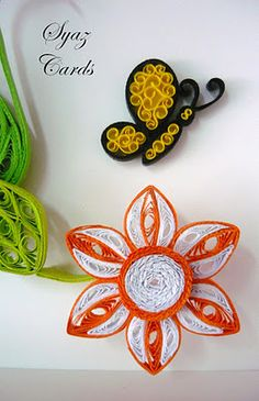 quilled butterfly & flower. Really cute butterfly using the beehive technique
