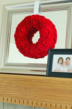 Such simple elegance in any color for any occasion. Felt fabric cut into circles, folded and pined to a styrofoam wreath hung by a ribbon.