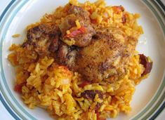 Chicken and chorizo paella is a lovely Spanish recipe; this tasty dish is really easy to make, not expensive at all and it doesn't contain seafood Tasty Dishes, Food Dishes, Arroz Risotto, Mexican Chorizo, Chicken Chorizo, Lunches And Dinners, How To Cook Chicken, Food To Make, Chicken Recipes