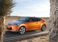 2014 Hyundai Veloster: While it was last year's No. 1 on the cool cars list, it continues to place well this year for its masterful mix of bold, unique style and famous Hyundai value. Hyundai Models, Hyundai Cars, Hyundai Vehicles, Hyundai Veloster, Accent Hatchback, Bbc, Good Looking Cars, Hyundai Genesis, Hyundai Accent
