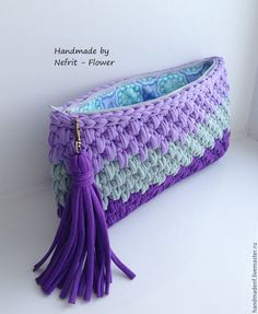 Nice crocheted purple clutch.