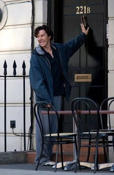 OCD Mycroft fixing the door knocker. Obnoxious little brother Sherlock messing it back up again.