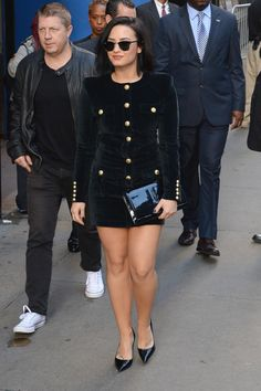 Demi Lovato wearing Ray-Ban 3016 Clubmaster Sunglasses, Saint Laurent Belle De Jour Patent Leather Clutch, Tom Ford Black Patent Leather Pin Heel Pumps and Balmain Velvet Cargo Shirtdress