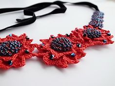 An eye-catching and stylish choker. This choker is crocheted per Irish crochet lace technique for the red motif made (accented with Japanese seed