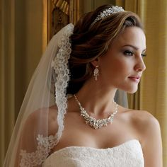This gorgeous jewelry set will look wonderful on any classic or vintage inspired bride! This captivating silver plated vine and leaf jewelry set is preciously adorned with fabulous freshwater pearls, glamorous marquise and round cut rhinestones and vivid aurora borealis rhinestones.  Kim's Bridal, Keywords:   #michiganbridalshop #weddingaccessories #kimsbridal Follow Us: http://www.kimsgiftbaskets.com/ ... https://www.facebook.com/KimsGifts