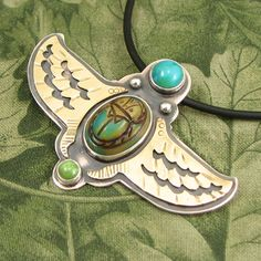 """Winged Scarab Pendant - """"Transcendence 1"""" Turquoise, Gaspeite and molded glass Scarab - Sterling with Brass Wings - OOAK by marybird on Etsy"""