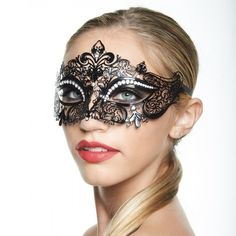 Exotic Black Crown with Luxurious Rhinestones -Made with eco-friendly metal material. -Laser Cut -Beautiful Rhinestones design.  -One size fits most. -Perfect for masquerade balls, weddings, proms, parties, dances, music festivals, raves, Mardi Gras, etc. -Held together with satin ribbons on both sides Accessories