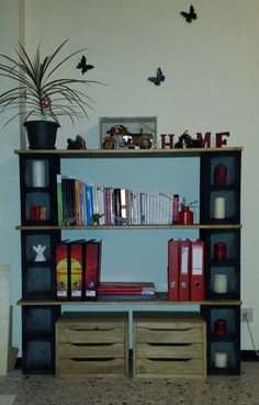 My 1st handmade bookshelf; cinder blocks & wood. Love the result! (sorry for the bad quality of the photo)
