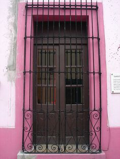 Pink with wrought iron