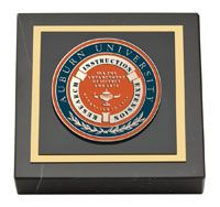 """Auburn University Paperweight - Our Masterpiece Medallion Paperweight features a custom-minted medallion of your school seal enhanced with hand-painted color enamel accents. The medallion is set into a genuine polished marble base. It comes beautifully gift boxed. Overall dimensions are 3"""" x 3"""" x 7/8."""""""