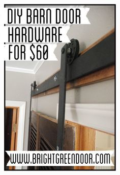 DIY Affordable Barn Door Hardware (good start, just shorten metal straps that connect to the door front)