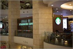 Starbucks at Terminal 21 Bangkok – the new shopping temple - european feeling at this huge mall - Bangkok, Thailand - next to Sheraton Grande Sukhumvit Hotel