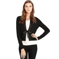 Tommy Hilfiger women's sweater. Every girl could use a little shimmer, and what better way to shine than in this soiree-ready cardigan? Irresistibly soft, it's begs for a mistletoe moment. • Classic fit.• 60% cotton, 40% acrylic. • Sequin appliqué, bow closure, signature micro plaque on cuff. • Machine washable.• Imported.