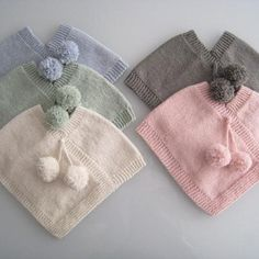 Practical & cute clothing - easily removed without unbuckling carseats - just slip on, slip off. Choice of soft pompoms or tassels. Sized for newborn babies and infants these ponchos are knitted in merino wool and are either natural or coloured using Knitting For Kids, Loom Knitting, Baby Knitting Patterns, Hand Knitting, Crochet Patterns, Crochet Poncho, Love Crochet, Kids Poncho Pattern, Baby Hut
