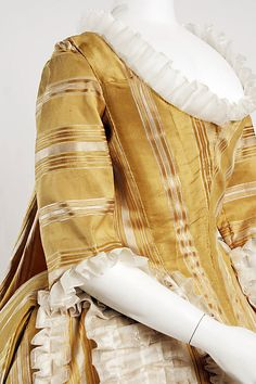 Detail front view, robe à la francaise, Europe, 1750-1775. Yellow and white striped silk.