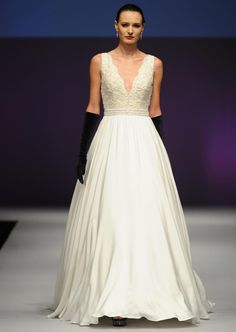 Yumi Katsura Fall 2016 lace tank neckline A-line wedding dress with beaded sash | https://www.theknot.com/content/yumi-katsura-wedding-dresses-bridal-fashion-week-fall-2016