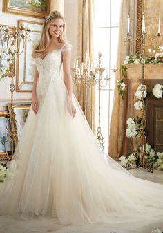 Embroidered Appliques on Soft Net Trimmed with Diamante Beading Wedding Dress Designed by Madeline Gardner. Removable Tulle Overskirt included.