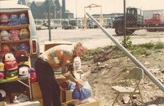 """Chuck McGinty. June, 1976. """"Walking Death"""" at his """"vanstand"""" on Wells just north of Comiskey Park."""
