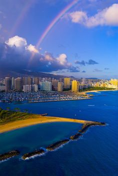 Aerial view of the Ala Wai Yacht Harbor with Waikiki behind and a rainbow overhead, Honolulu, Oahu, Hawaii...