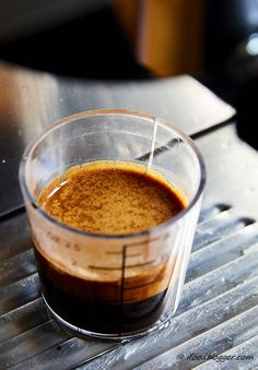 A comprehensive guide on how to make espresso at home like a pro. Homemade espresso will cost you 10 times less and will rival best espressos out there. Completed perfect espresso shot.