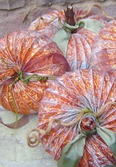 Create your own patch of metallic pumpkins by looping together extra dryer vents, giving them an autumn-friendly paint job, and adding ribbon and grapevine for decoration. Get the tutorial at Finding Secret Treasure. Metal Pumpkins, Painted Pumpkins, Fall Pumpkins, Diy Pumpkin, Pumpkin Crafts, Leaf Crafts, Fall Crafts, Fall Halloween, Halloween Crafts