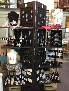 Great display made with bi-fold shutters and wood shelving. www.etsy.com/shop/jjbotanics