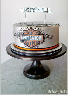 Let's have a little fun! This cake design by The Pastry Studio is for all you Harley Davidson lovers out there. The detail work on the logo is amazing, doesn't this cake look too good to eat? #wedding, #cake_stand, #cakestand