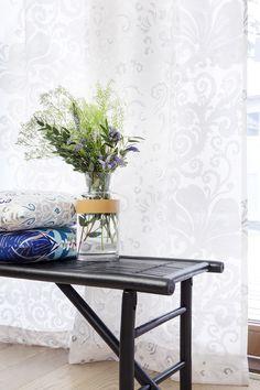 Naimakauppa fancy curtain and Naimakauppa cushion by Tanja Orsjoki, Loitsu cushion by Matleena Issakainen