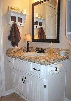 white cabinets and dark mirror with our granite countertop- similar tone to tile in this pic