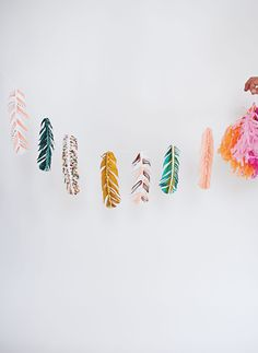 What a beautiful painted feather garland! Would look gorgeous strewn up a boho wedding!