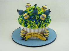 A giant mud cupcake with a fondant case and buttercream frosting on top. The minions are handmade from fondant. Giant Cupcakes, Buttercream Frosting, 3rd Birthday, Mud, Minions, Fondant, Cake Decorating, Special Occasion, Wedding Cakes