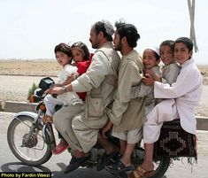 A reckless Indian family on a Motorcycle ( well the whole family was TYREd !! )