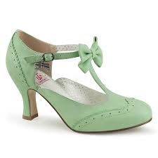Pinup Couture mint bow t-strap retro kitten heel pumps. These vintage inspired heels are essential for any Pin-Up. Finished with a faux leather adjustable strap design. Pin Up Shoes, Cute Shoes, Me Too Shoes, Style Rockabilly, Rockabilly Shoes, T Strap Shoes, Fashion Shoes, Prom Shoes