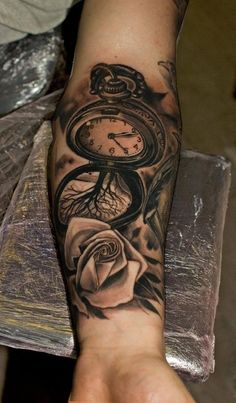 Left Forearm Grey Ink Rose And Pocket Watch Tattoo
