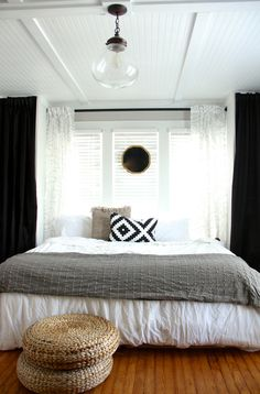 4x8 beadboard panels with mdf trim on the ceiling to cover horrible texture or popcorn ceilings.  Class!